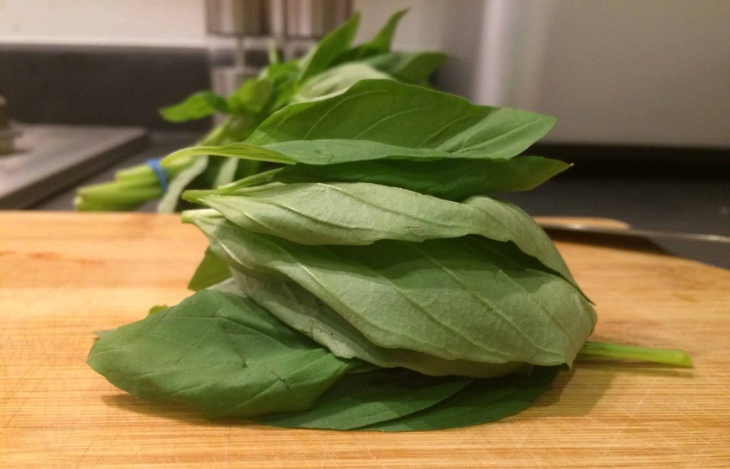 A pile of Basil on a chopping block
