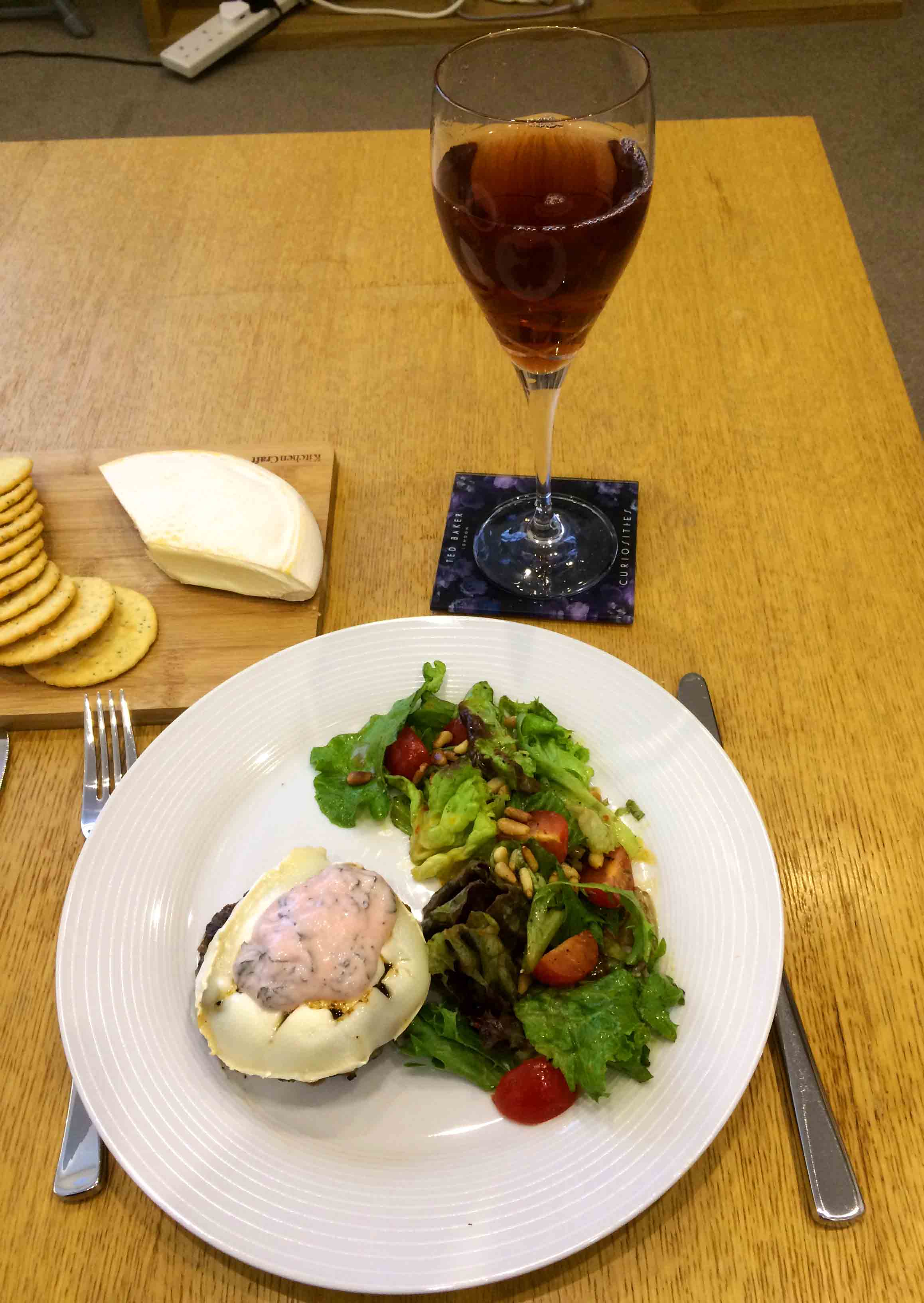 Lamb burger with goats cheese and side salad. With a glass of Ribena Winter Spice.