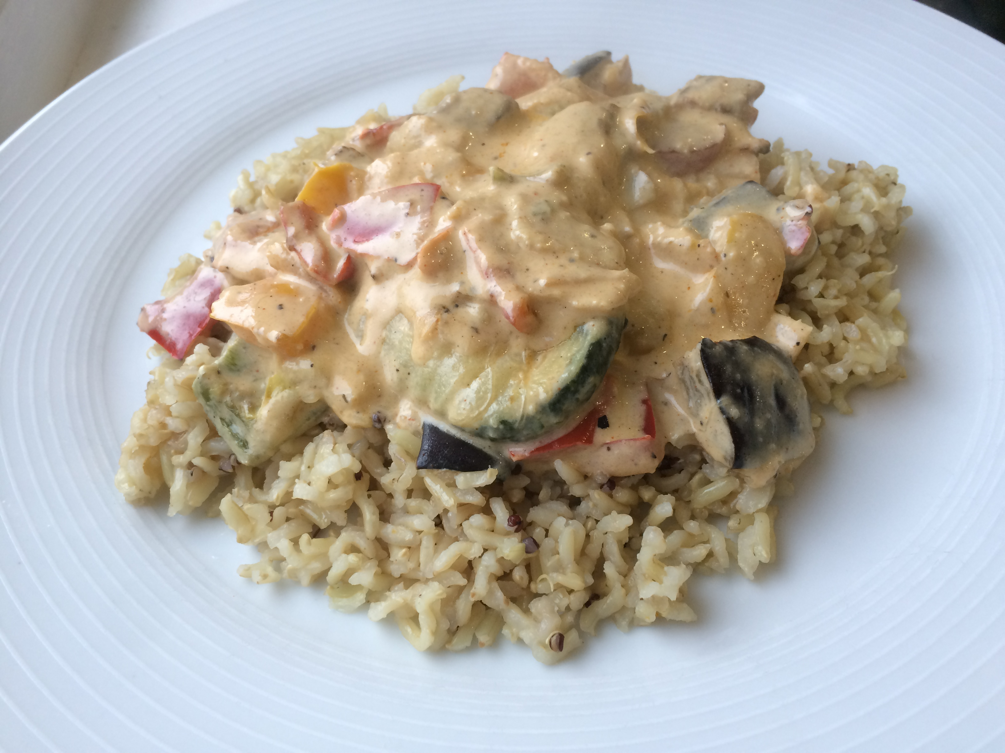 Grilled vegetables with cream cheese and served on rice.