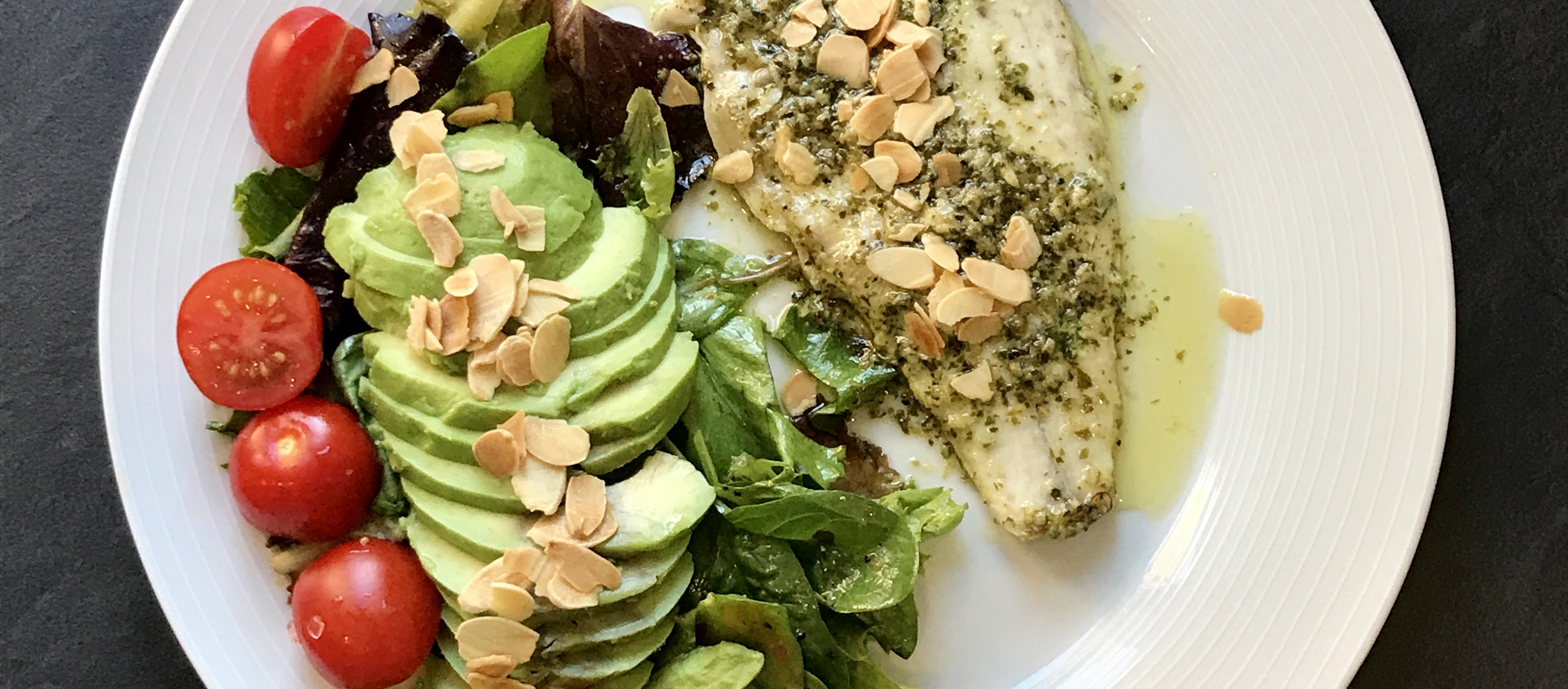 Pesto sea bass and almonds with a tropical salad