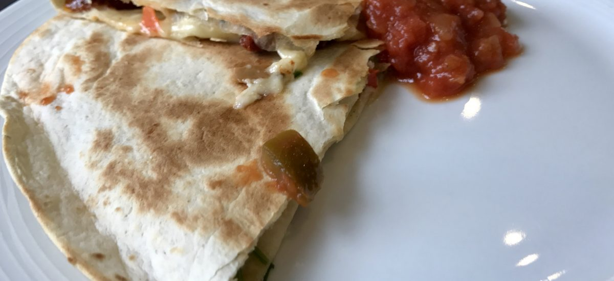 Sundried tomatoes, red peppers, and coriander quesadilla